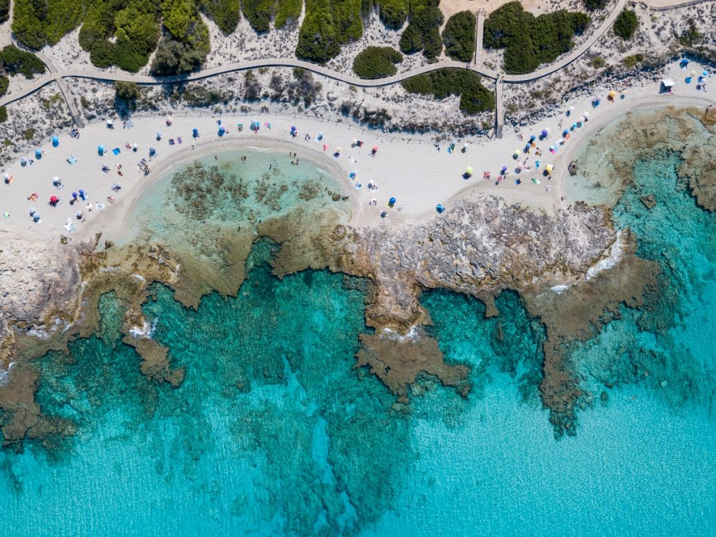 Aerial photo of beach bays with sunshades.
